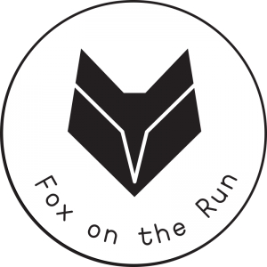 Green fox on the run